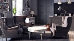 A lobby with SANDMON grey wing chairs and ISALA coffee table