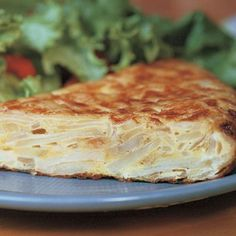A closer relative to the Italian frittata than a Mexican flour or corn tortilla, a Spanish tortilla is so much more than the sum of its humble parts. Potatoes are the star, but tortillas welcome variation. The tortilla makes an excellent breakfast, lunch, dinner, snack, or crowd-pleasing tapa. If you have a mandoline, this would be a great time to use it. If you've never used one, or it's been a while, watch our video on how to use a mandoline.