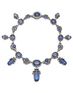 An antique sapphire and diamond necklace, circa 1840, formerly in the collection of a European noble family. Set with oval, cushion-shaped and step-cut sapphires, circular-cut and cushion-shaped diamonds.