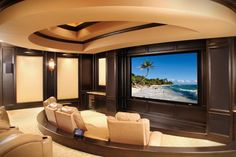 Luxurious and sophisticated home theater design in cream and dark wood. 1 of 10 projects by House of L.