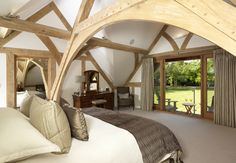 Master bedroom with arch braced oak truss. French doors open out onto covered balcony that overlooks rear gardens. Oak Framed Extensions, House Extensions, Oak Bedroom, Bedroom Decor, Master Bedroom, Dream Bedroom, Loft Conversion Design, Oak Frame House, Self Build Houses