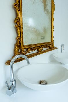 This vintage mirror contrasts so beautifully with the clean, modern lines of our bathroom
