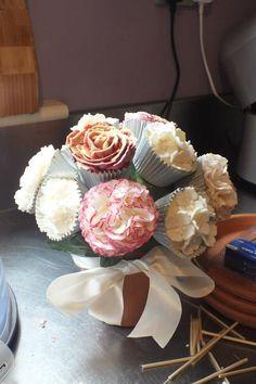 cupcake bouquet featuring buttercream roses, sugar carnations and sugar hydrangeas