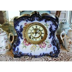 Antique Porcelain Clock Ansonia Cobalt Blue 1881-92 Open Escapement Chiming 8 Day Strike Chime Mantel Parlor Victorian Era Floral Royal Bonn ($1,999) found on Polyvore featuring home, home decor, clocks, chiming mantel clocks, cobalt blue home decor, mantel clocks, floral home decor and chiming clocks