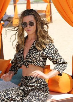 Looking good:Donning a colourful co-ord, the 31-year-old wife of footballer Peter Crouch ...