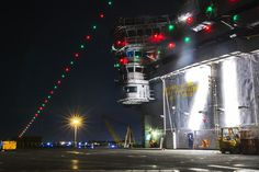 The aircraft carrier USS Theodore Roosevelt (CVN 71) displays holiday lighting while moored at its homeport of Naval Station Norfolk, Dec. 2...
