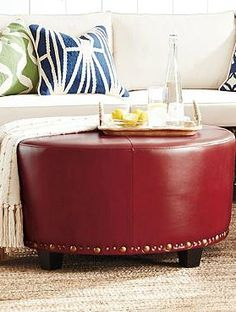 Sturdy enough to serve as a coffee table, and comfortable enough for extra seating, the Wareham Round Ottoman is a handsome and versatile piece perfect for your living room.