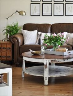 Some terrific ideas on how to decorate and lighten up around those dark leather pieces of furniture. This has given me some great ideas cause I need to get away from all the brown I have.......D.