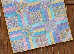 Pastel Spring Meadow Baby Girl Quilt Pink Violet Blue Yellow Handmade Floral Butterfly Crib Blanket by JennyMsQuilts on Etsy https://www.etsy.com/listing/180913805/pastel-spring-meadow-baby-girl-quilt