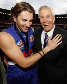 Marcus Bontempelli of the Bulldogs and John Schultz celebrate during the 2016 Toyota AFL Grand Final match between the Sydney Swans and the Western...