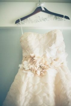 Strapless Vera Wang wedding gown with flower petal detailing | photography by http://www.lovetheschultzes.com