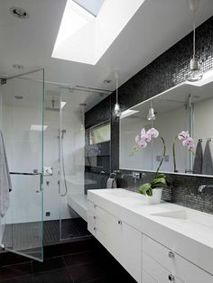 Floating countertops, glass tile, glass door, lights, invisible sinks.