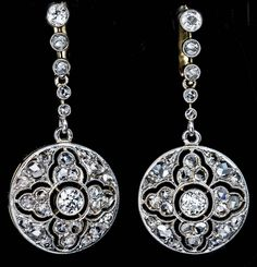 Antique Diamond Platinum Openwork Dangle Earrings | From a unique collection of vintage drop earrings at https://www.1stdibs.com/jewelry/earrings/drop-earrings/