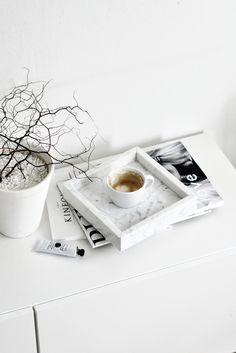 Marble tray and magazines in a white minimal home