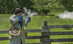 Smoke erupts as Brad Grebner fires a .45-caliber rifle at the annual Fort Crevecoeur Rendezvous and Gathering Sunday at Fort Crevecoeur Park in Creve Coeur.