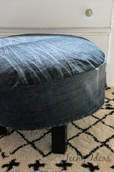 slipcoverd ottoman from old jeans