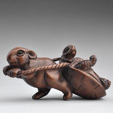 Netsuke  The tortoise and the hare?
