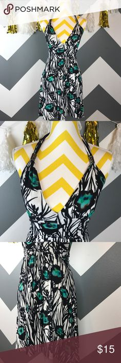 Express Abstract Print Halter Dress This Express Halter tank dress features an abstract black and white leaf pattern with peacock-colored accent pops!  The tie neckline is adjustable and features substantial black and sliver beads. The banded and gathered waistline is stretchy and flattering and the skirt floats away from the body hitting above the knee. This is a perfect summer Sundress! Express Dresses Backless