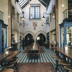 A dining room that would make any Harry Potter fan swear they were eating in the Hogwarts' great hall. :)