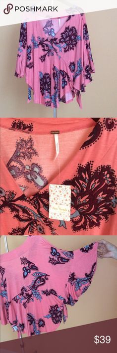 NWT FREE PEOPLE PASSION FLOWER Beautiful pea hush orange color this top so soft comfortable yet super fashionable 95% Rayon 5% Spandex. Machine wash cold 🌺 Free People Tops Blouses