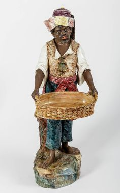 Blackamoor Majolica Statue | From a unique collection of antique and modern sculptures at https://www.1stdibs.com/furniture/decorative-objects/sculptures/