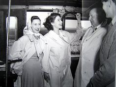 Young Princesses Elizabeth & Margaret laughing on a train