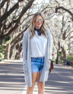 Ripped jean shorts and oversized gray cardigan. Mirrored sunglasses, Bandana