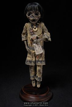 https://flic.kr/p/aRoK1g | Mummy Art Doll Sculpture – M42 | Mummy Art Doll Sculpture – M42  Please see my Profile Page for more information.  Handmade Doll Sculpture. 8.25 inches tall. Mixed media.  Copyright © 2011, Shain Erin. All rights reserved.
