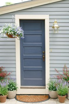 Light Blue Siding Repainted Shutters To Black Would Like
