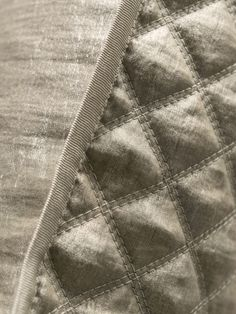 Opera Quilted Cushion in Agate. With a matt appearance on one side and a gloss on the other this versitile finely woven linen Opera fabric is reversible.
