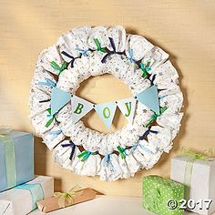 Need a baby shower decorating idea that's not a diaper cake? Try this Diaper Wreath as a creative alternative. Complete with pennant banner, this wreath ...
