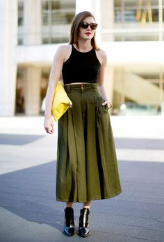 Yes, crop tops can be minimizing.   The key with a crop top is to rock one in the appropriate size. Make sure it comes down to your natural waist, and wear a high-waist skirt or trousers to...