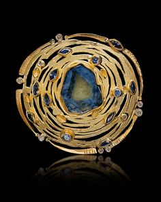 Brooch by Judith Kaufman. Photo by Mark Nantz Photography.
