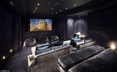 The property features a plush cinema room with sofa bed style seating. With 15,000sq/ft of living space the size of the home gives it a cost...