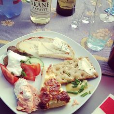 This is just awesome! Midsommar celebrations with friends complete with aquavit, sill (herring) and Canada flag napkins! #midsommar #helsingborg #sweden