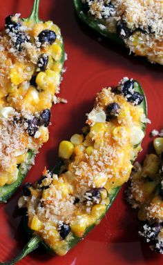 Black Bean Jalapeno Poppers - Ingredients 12 jalapeno peppers 4 ears corn 1 (14.5 oz) can black beans, drained 6 ounces sharp Cheddar cheese, grated 1/2 cup sour cream salt and black pepper, to taste 1/2 cup panko breadcrumbs 1/2 teaspoon smoked paprika 1/2 teaspoon salt Instructions Heat oven to 350°F