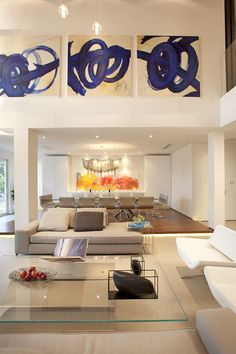 Idea for my tall wall in living room! modern living room by DKOR Interiors Inc.- Interior Designers Miami, FL
