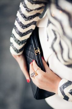 Chevron print shirt and Chanel clutch