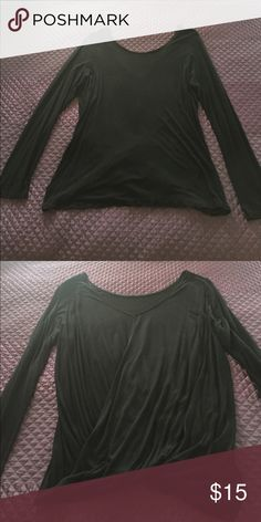 Express black long sleeve top Express black long sleeve top. Second photo shows the back with the blouses crossed design. Super cute and comfortable. Worn a couple times but in great condition. Express Tops Tees - Long Sleeve