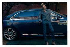 The 2017 Lincoln Continental ad campaign features musician Jon Batiste, artist Tali Lennox, actor Giles Matthey and director Ben Younger in and around the automaker's 2017 Continental, set against downtown backgrounds and country landscapes. Pictured: Jon Batiste. Photography by Annie Leibovitz.
