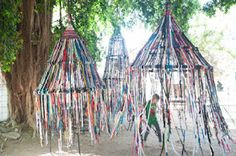 Pavilions made from finger-knit ropes suspended from hoops in trees (via playscapes)