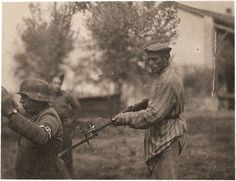 Liberated Jewish man holds NAZI soldier at gunpoint during WWII, unknown date.... picked to show the  hatred Jews had for Nazis