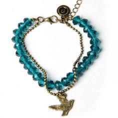 Goudkleurige JWLZ armband met turquoise kralen en een ball chain met een vogelbedeltje. www.JWLZ.nl