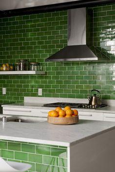 Green subway tile makes a big impact in a sleek kitchen.