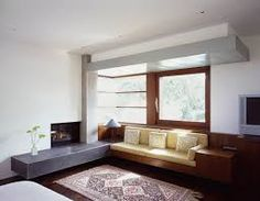 Image result for modern fireplace with raised hearth