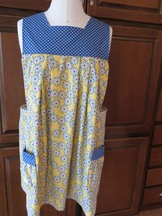 A personal favorite from my Etsy shop https://www.etsy.com/listing/219843450/apron-pullover-smock-style-apron-with