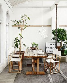 Rustic dining space setting with white folding chairs