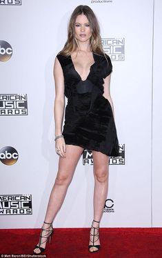 Red carpet debut! Behati Prinsloo made her first official appearance at the 2016 American Music Awards in Los Angeles on Sunday since welcoming daughter Dusty Rose on September 21 with husband Adam Levine