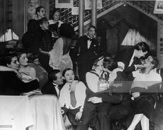 Photo d'actualité : A group of patrons, many dressed as men in...