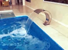 Stainless steel cascade for spa area, by Piscinas Godo. http://piscinasgodo.com/proyectos/proyecto-bisazza-etoiles-blue/